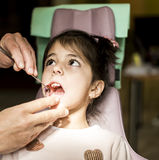 Little girl at the dentist checkup Stock Photos