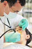Little girl at a dentist examination Royalty Free Stock Image