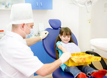 Little girl at dentist's office Stock Photos