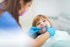 Little girl in the dentists office stock photos