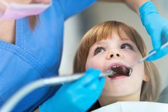 Little girl in the dentists office royalty free stock image