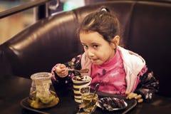 Little girl dessert Stock Photos