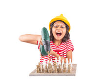 Little Girl Destroy Chess With Drill IV. Concept image of little girl destroying a stone chess set with power drill royalty free stock images