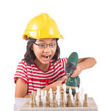 Little Girl Destroy Chess With Drill V. Concept image of little girl destroying a stone chess set with power drill stock image