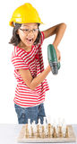 Little Girl Destroy Chess Set WIth Drill I. Concept image of little girl destroying a stone chess set with power drill stock photos