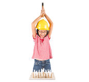 Little Girl Destroy Chess Set WIth Hammer III. Concept image of little girl destroying a stone chess set royalty free stock image