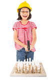 Little Girl Destroy Chess Set WIth Hammer IV. Concept image of little girl destroying a stone chess set royalty free stock photo