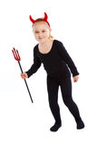 Little girl in devil costume. Royalty Free Stock Photography