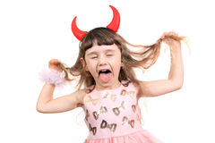 Little Girl with Devil Horns. Naughty Little Girl with Devil Horns on the White Background Royalty Free Stock Images