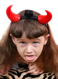 Little Girl with Devil Horns. Naughty Little Girl with Devil Horns on the White Background Royalty Free Stock Image