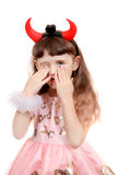 Little Girl with Devil Horns Stock Photo