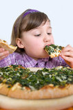 Little girl devours Pizza Stock Image
