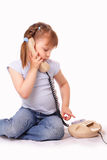 Little girl dials the number on the old phone Royalty Free Stock Images