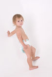 Little girl in diaper is looking Royalty Free Stock Photography