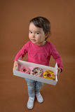 Little girl  with different donuts Royalty Free Stock Photos