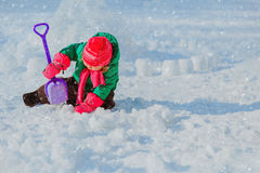 Little girl dig and play in winter snow. Little girl dig in winter snow, kids winter fun stock image
