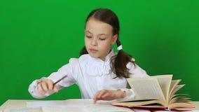Little girl diligently doing their homework. stock video