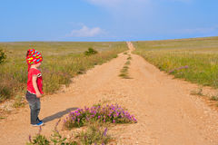 Little girl by dirt road Stock Images