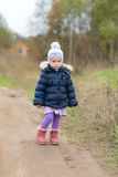 Little girl on a dirt road Royalty Free Stock Photo