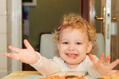 Little girl with dirty facel eating cookie Stock Photography