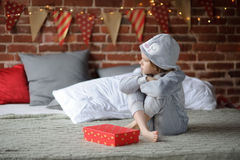 Little girl is disappointed with a gift. Stock Image