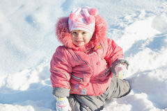Little girl discovering snow Stock Photography