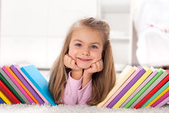 Little girl discovering the world of books Royalty Free Stock Photos