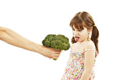 Little Girl Disgusted with Broccoli Stock Photos