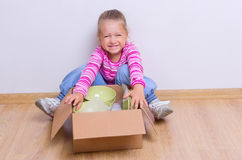 Little girl with dishware Royalty Free Stock Images
