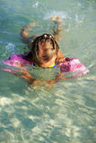 Little girl dives. In the clear sea Stock Photography