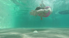 Little girl dives to the shells stock video footage