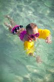 Little girl with diving in the sea in nice Royalty Free Stock Images