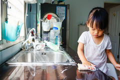 Little girl do housework Royalty Free Stock Photos