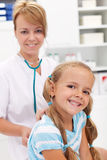 Little girl at the doctor for a checkup Stock Image