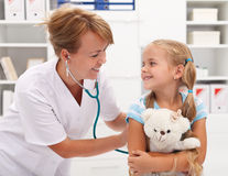 Little girl at the doctor for a checkup examination Royalty Free Stock Photos