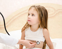 Little girl and the doctor for a checkup examined Stock Images