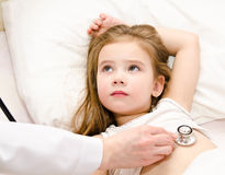 Little girl and the doctor for a checkup examined Royalty Free Stock Photography