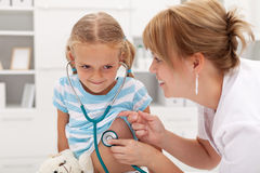 Little girl at the doctor for a checkup Royalty Free Stock Photography