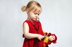 Little girl in doctor Stock Photos