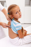 Little girl at the doctor for an examination Royalty Free Stock Photography