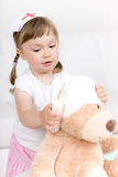 Little girl doctor with teddy bear Stock Photos