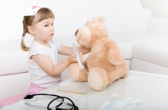 Little girl doctor with teddy bear Stock Image