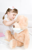 Little Girl Doctor With Teddy Bear Stock Photography