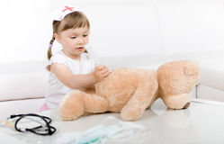 Free Little Girl Doctor With Teddy Bear Royalty Free Stock Images - 14725139