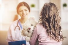 Little girl in a doctor royalty free stock photography