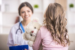 Little girl in a doctor Stock Image