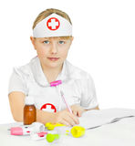 Little girl in a doctors uniform Stock Image