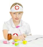 Little girl in a doctors uniform Stock Image