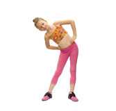 Little girl does exercises Stock Photos