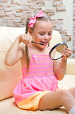 Little girl does makeup Stock Images